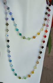 step by step instruction for making three strand beaded necklace
