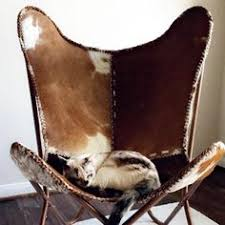 cow hide covered wing chair pesquisa google western decor