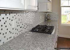 White Kitchen Backsplash Tile by Luna Pearl Granite Countertop With White Glass Metal Kitchen