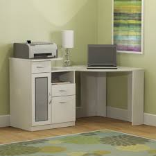 interior white modern stained manufactured corner desk and laptop