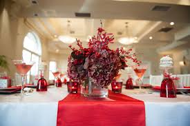 banquet table decorations for christmas with red basket and green