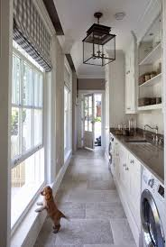 a glamorous laundry room connects the kitchen to the outdoors