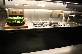 must have elements for a dream kitchen arclinea s counter with cooktop and sink has lots of functional extras