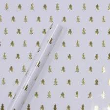 gold foil trees on white wrapping paper sugar paper target