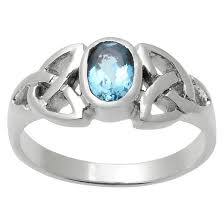 set ring 1 6 ct t w oval cut topaz celtic knot bezel set ring in sterling