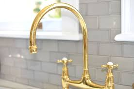 traditional kitchen faucets remarkable modest unlacquered brass kitchen faucet 10 easy pieces