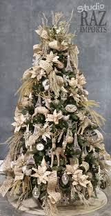 a lovely raz studio tree decorated in all white with