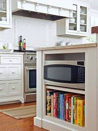 microwave oven in the kitchen island over bookcase microwave