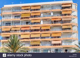 a block of apartments on the costa del sol spain with sun shades