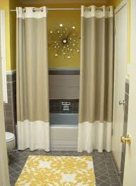 use curtain panels instead of a shower curtain when you have a two