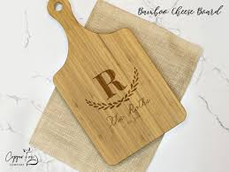 personalized cheese board engraved with kitchen utensils copper