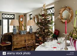 christmas tree in cottage dining room with antler decorated