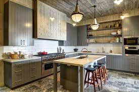 country gray kitchen cabinets gray paneled kitchen cabinets country kitchen john hummel