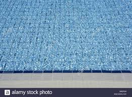 blue tiles pool water waves perspective summer background stock