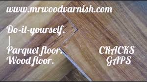 How To Repair Laminate Wood Flooring Do It Yourself How To Fix Parquet Wood Flooring Gaps Cracks 7