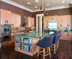 a big wooden kitchen island with storage and glass countertop