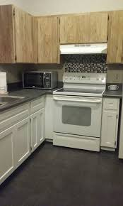 how do you fill the gap between kitchen cabinets and ceiling how can i fill a blank space in my kitchen hometalk