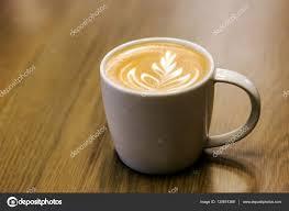 late art in mug of coffee u2014 stock photo yanukit 130674368