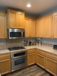 painting kitchen cabinets with chalk paint how to refinish your kitchen cabinets brushed by