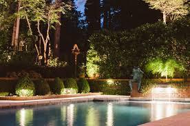 lighting around pool deck landscape lighting around pool round designs