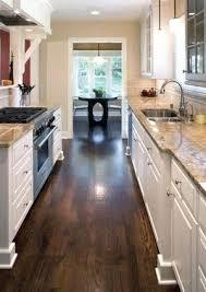 white kitchen black worktop wood floor medium floors cabinets with