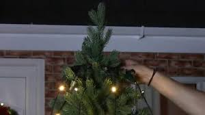 Put Lights On Christmas Tree by How To Put Lights On Your Outdoor Tree With A Ring Connector Youtube