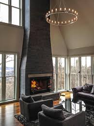 niche spark modern chandelier hanging above a living room space