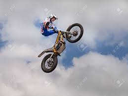 motocross stunts freestyle a stunt biker make an acrobatic jump at the trial and motocross