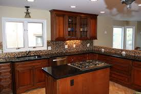 kitchen islands with stoves transitional townhouse kitchen with island and stove xcelrenovation