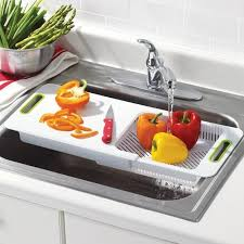 An Adjustable OvertheSink Cutting Board Cool Products - Small sink kitchen