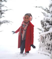 snowstorm warm in red coat pink earmuffs this season s gold