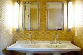yellow penny tiles add golden glint to the small bathroomjpg