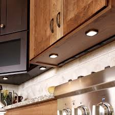 under upper cabinet lighting a hidden electrical strip mounted under the wall cabinets in the