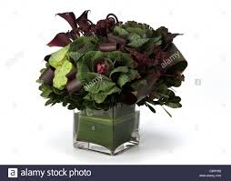 a colorful bouquet of flowers in a vase ornamental cabbage water
