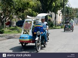 philippine tricycle tricycle and cycle rickshaw on the streets of silay in the stock