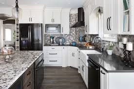 gray kitchen cabinets with black stainless steel appliances how to hide your refrigerator in plain sight with appliance