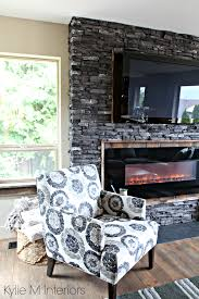 charcoal ledgestone fireplace update with reclaimed rustic wood