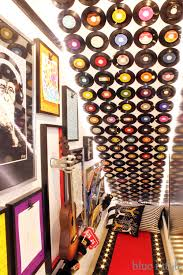 How To Hang Pictures On A Wall Diy With Style How To Cover A Wall In Vinyl Records Damage Free