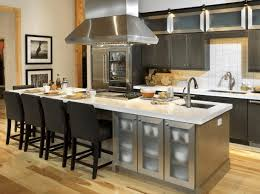 kitchen island with range kitchen sink ceiling light cooktop faucet vinyl floor modern