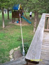 pulley system with bucket that goes from our deck to the