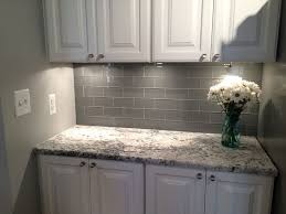 backsplash tile ideas small kitchens grey glass subway tile backsplash and white cabinet for small