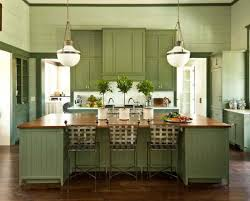 traditional kitchen with green cabinet colors and walls with