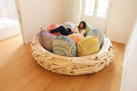 the giant birdnest a cozy wooden bed filled with egg shaped pillows