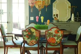 attractive hanging lamp above round dining table around painted
