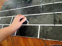 painting kitchen tile backsplash ve tiled backsplashes before in painting your backsplash to resemble slate subway tiles sawdust and