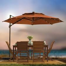 offset patio umbrella with led lights bed bath beyond 11 foot round solar cantilever umbrella in fern