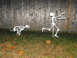 halloween skeleton decoration dog skeleton chasing person