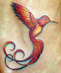 bright colored hummingbird with curled tattoos photos