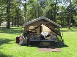 easy to set up 8 person log cabin lodge tent with a screen porch