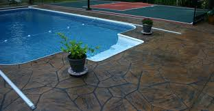 concrete toppings for swimming pool deck coatings using a